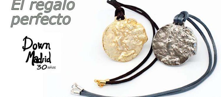 Cartela web promocionando colgante de plata conmemorativo de Down Madrid